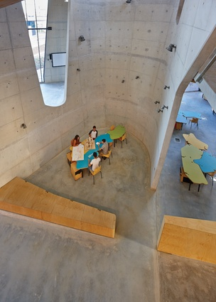 """Large bespoke concrete """"scoops"""" splay out from bottom to top."""
