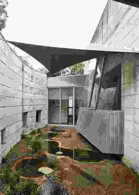 """The architects offered a design """"with some surprises,"""" including the central courtyard featuring a series of ponds."""