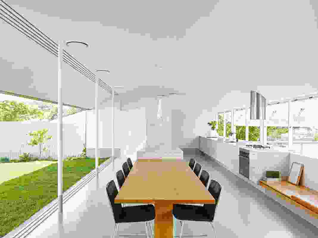 "The kitchen pavilion sits between the two primary gardens and acts as a viewing platform for the ""playing field."""