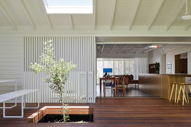 Transitional zones on either side of the main living area provide cross-ventilation and shade.