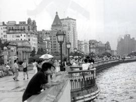 On the Bund, with the old part of the city in the background.