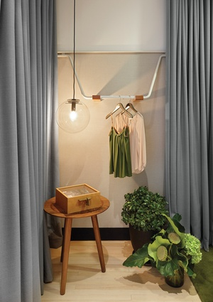 The dressing rooms feel intimate thanks to a combination of drapery, lighting, furniture elements and greenery.