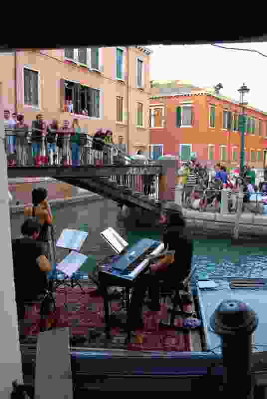 A Venetian band plays on a barge at the opening of Finding Country at the 2012 Venice Architecture Biennale.