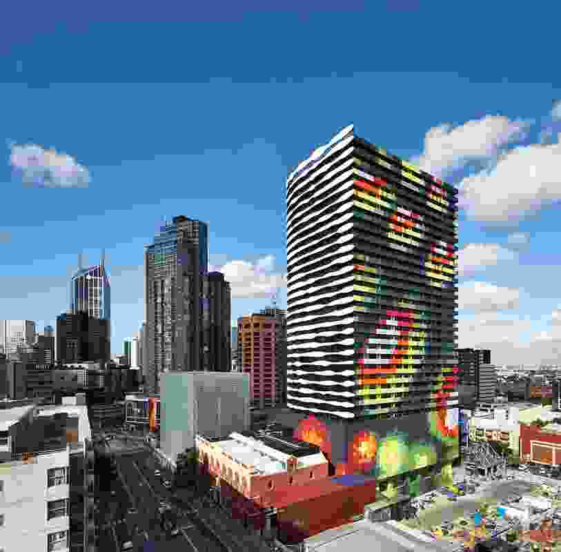 Swanston Square's eastern and southern facades create the black-and-white image of William Barak while the northern and western facades have a multicoloured pattern reminiscent of a topographic map.