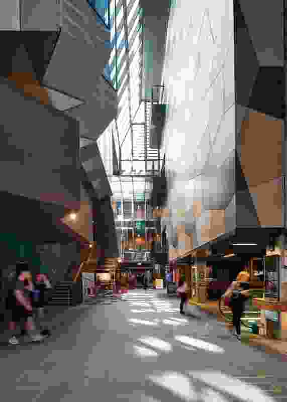 "The ""New Academic Street"" forms the project's north–south primary spine. Together with a series of east–west laneways, this creates a new circulation diagram through the existing concrete buildings, which mirrors the city grid."