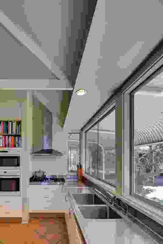 The bullnose verandah shades each room and frames the views.