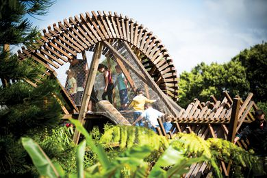 Visitors clamber through the fantastically twisty timber treehouse at the Ian Potter Children's Wild Play Garden.