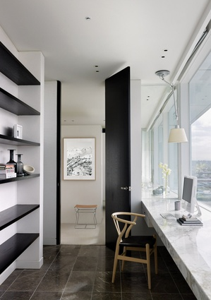 The galley-style study leads to the master bedroom.