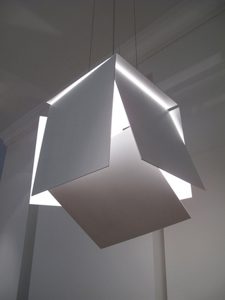 The steel and aluminium surfaces of Robert Hoffmann's Modular Lights can be turned and tilted.