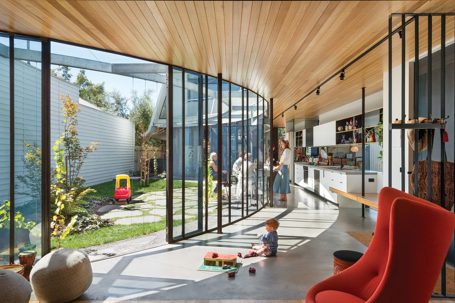 The expressive curve serves the practical purpose of delineating space while retaining familial connections.