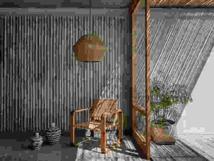 Bamboo was used to form the concrete walls, leaving impressions that accentuate shifting patterns of sunlight throughout the day.