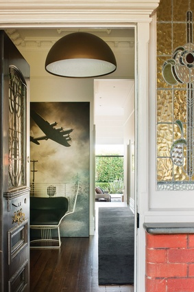 A hint of the living room garden wall is seen from the entry. Artwork: Michael Peck.