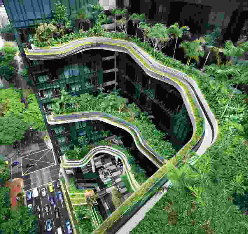 Sculpted garden terraces are located at four-floor intervals up the side of the building.