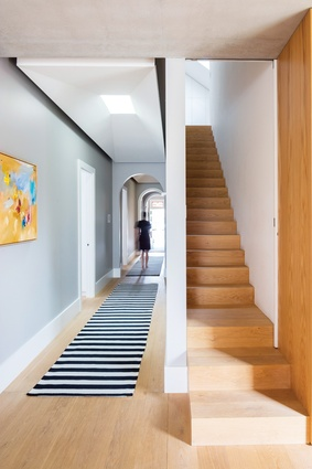 The long corridor of the original house has been retained, with two skylights bringing in new light. Artwork: Laelie Berzon.