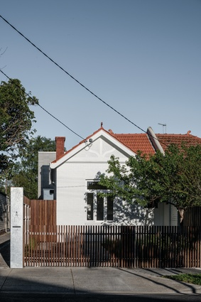 The extension is externally discreet, with a heritage facade hiding the dramatic interiors.