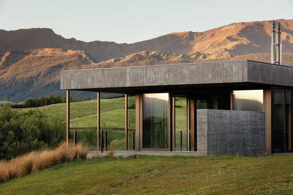On the inside and out, a combination of Corten steel, shuttered concrete and schist in the home gives a rustic look that merges nicely with the landscape.