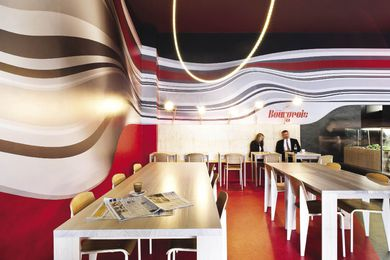 A rippling custom wallpaper design wraps around the interior of Cafe Bourgeois.