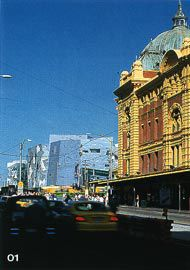 Looking along Flinders Street, with the railway station in the foreground and the forms of Federation Square beyond.Image: Trevor Mein.