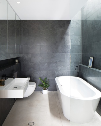 Featuring Brazilian slate wall tiles, the ensuite is a compact yet beautiful space in which to unwind.
