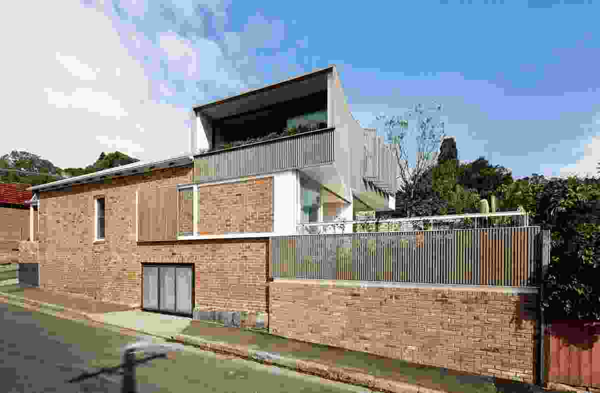 Two main dwellings are augmented by a third studio space.