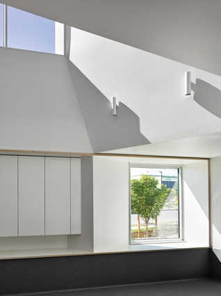 """Save for skylight windows and """"delightfully unexpected"""" garden views, the interiors are pared back and refined."""