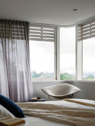 The windows in the main bedroom wrap around the corners to allow unhindered views of Sydney Harbour.