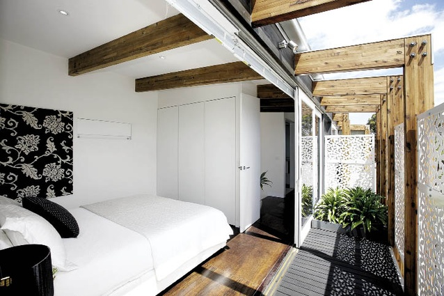 The main bedroom of each apartment opens out onto a private terrace.