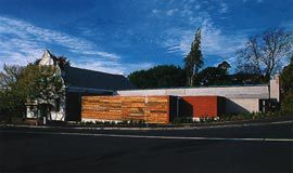 View from the corner of Tamar and Brisbane Streets. The existing Price Memorial Hall is to the left and the main entrance lies between the timber-clad service building and the hall. Image: Leigh Woolley