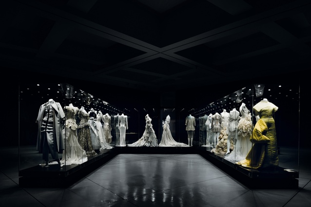 "The ""palette and texture"" room features large, intersecting glass cases of dresses."