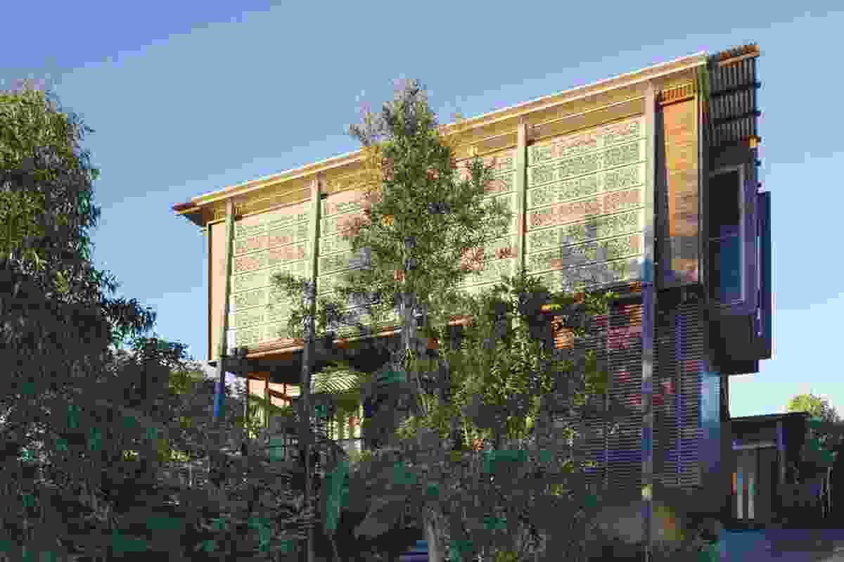 The facade with perforated anodized panels.