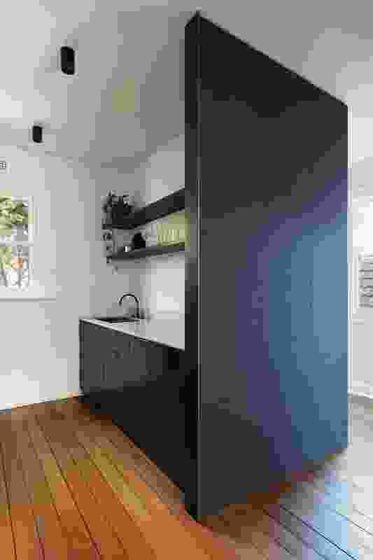 "A contemporary insertion in the historic fabric of Princes Apartment, this ""services pod"" houses a kitchen and laundry."