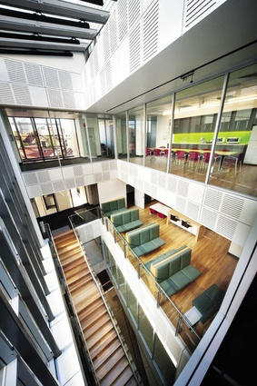 A light-filled atrium connects levels three to seven, relieving the usual closed corridors  of hospital facilities.