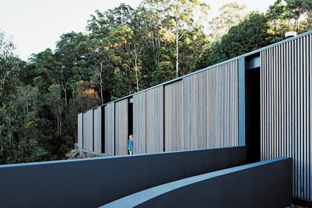 Sliding timber screens, reminiscent of Japanese tea houses, provide for the control of light, privacy and outlook.
