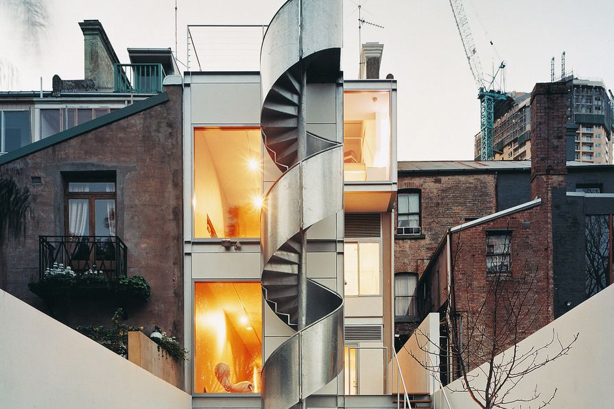 The striking aluminium-clad stair allows access to the garden and garage from the roof terrace without disturbing the occupants of the apartment below.