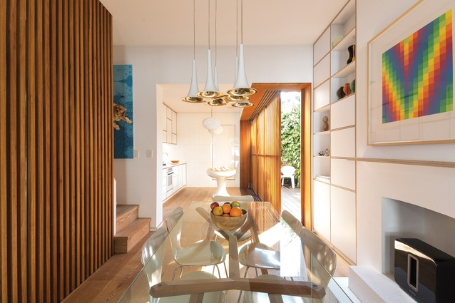 """The kitchen, once a dark and """"daggy"""" room, is now an extension of the dining space, showered in sunlight. Artwork (at right): Richard Paul Lohse."""
