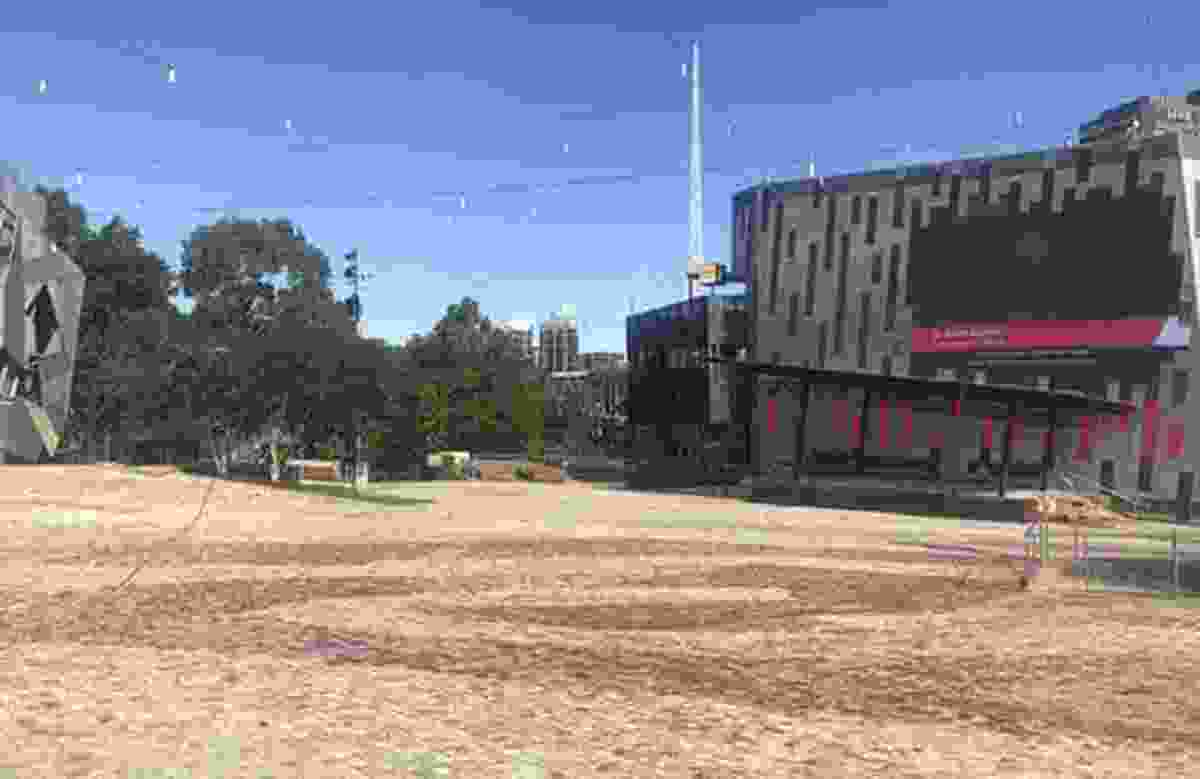 """At a deserted Federation Square in Melbourne, the big screen broadcasts this message: """"If you can see this, what are you doing? Go home."""""""