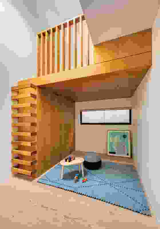 The playroom includes a hidden, pull-down bed for guests and a mezzanine space. Artwork: Christopher Cayetano, Untitled #23, 2012, from the At First Glance series.