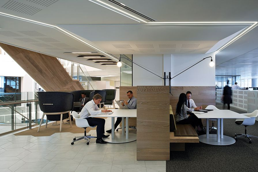 Communal work tables and meeting rooms inside ANZ workplace in Sydney designed by Hassell.