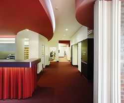 Looking from the reception area to the more domestic scale of the clinic waiting area and facilities.