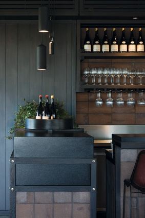 The bar unit is compact but effective, its solidity offset by an expressed frame that wraps around it.