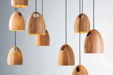 Oak pendant lights by Ross Gardam.