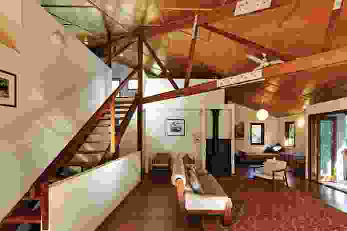 Stairs from the main living area lead to the sleeping loft above.