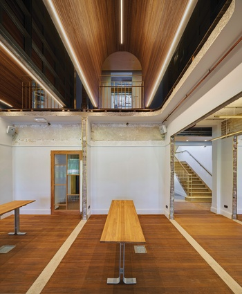 Timber-lined vaults, exposed brickwork, selective painting, raw edges and brass outlining – the design of the Esme Cahill building's interior spaces draws attention to the building's history and material layers.