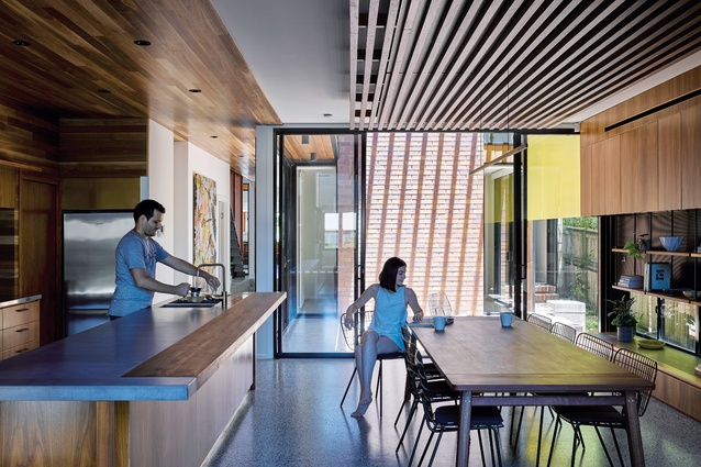 The central courtyard provides light, air and outlook to surrounding rooms. Artwork: David Bromley.