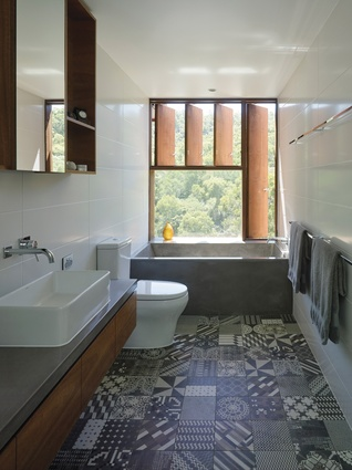 "A pattern of windows in different sizes is ""sprinkled"" over the walls, this one creating a relaxing spot for a bath."