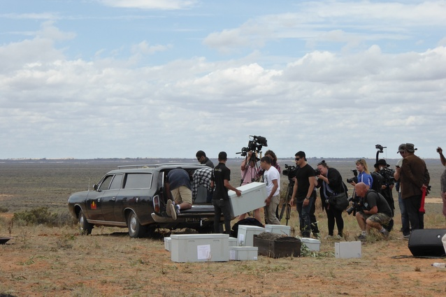 Mungo Man's remains are unloaded from the hearse during the Return to Country ceremony.