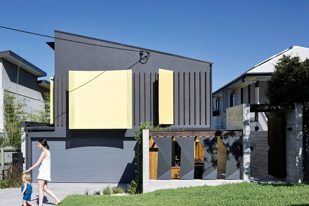 The control of light and views is celebrated through the use of brightly coloured steel light scoops and screens.