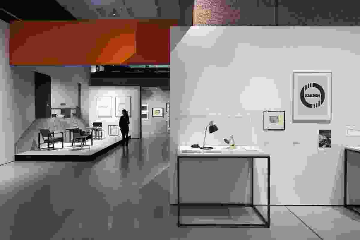 The exhibition displays are arranged in vignettes through the cavernous concrete gallery.