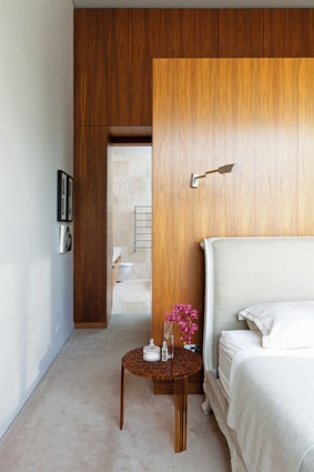 The main bedroom leads through an ensuite into a private courtyard with an outdoor shower.