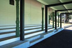 A new steel verandah stands forward from the original timber columns at the front of the pavilion.